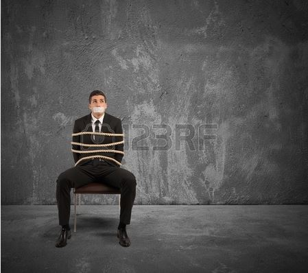 cryptolocker ransomware virus post has a man tied to a chair with his mouth taped shut